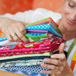 Seamstress choosing fabric — Stock Photo #27482085