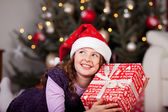 Little girl holding her Christmas gift — Foto Stock