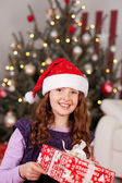 Beautiful laughing girl in a Santa hat — Stock Photo