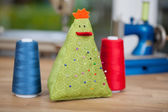 Pins On Pin Cushion With Bobbins At Workshop — Stock Photo