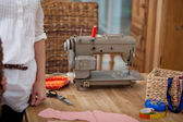 Fashion Designer Standing By Worktable In Workshop — Stock Photo