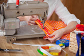 Seamstress with her sewing machine — Stock Photo