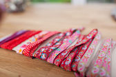 Various Laces Wrapped On Table In Workshop — Stock Photo