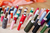 Multicolored Bobbins In Workshop — Stock Photo