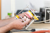 Technician's Hands Working With Articulator In Dental Laboratory — Stock Photo