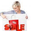 Blond Woman Showing Sale On Poster — Stock Photo