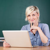 Smiling Young Teacher Using Laptop At School — Stock Photo