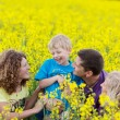 Happy familiy in agricultural field — Stock Photo #27668019