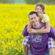 Father carrying teenage girl on his back — Stock Photo