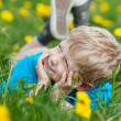 Cute boy lying on grass — Stock Photo