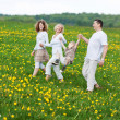Family having fun on a walk in nature — Stock Photo