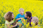 Happy familiy in agricultural field — Stock Photo