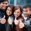 Stock Photo: Four motivated friends giving thumbs up