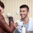 Young man and woman in a cafe — Stock Photo