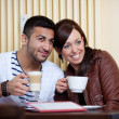 Loving Asian couple in a restaurant — Stock Photo #27748877