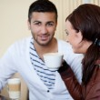 Stock Photo: young couple talking in a cafe