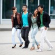 Stock Photo: Four friends walking through the city