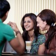 Friends at a cafe — Stock Photo #27749027