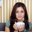 Beautiful woman and cup of tea — Stock Photo
