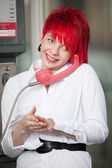 Woman with red hair at the phone — Stock Photo
