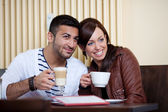 Loving Asian couple in a restaurant — Stock Photo