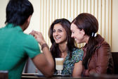 Friends at a cafe — Stock Photo