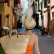 Stock Photo: Confident womcarrying straw shopping bag