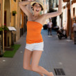 Exuberant young woman jumping for joy — Stock Photo