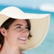 Portrait of a beautiful woman in a sunhat — Stock Photo #27774887
