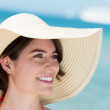 Portrait of a beautiful woman in a sunhat — Stock Photo