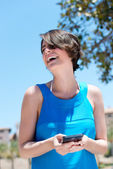 Woman laughing at the contents of an sms — Stock Photo
