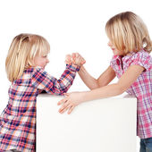 Little Girls Arm Wrestling Against White Background — Stock Photo