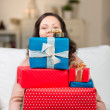 Woman carrying a huge pile of gifts — Stock Photo #27833959