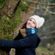 Woman In Winter Clothes Embracing Tree — Stock Photo