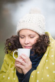 Woman enjoying a mug of tea in winter — Stock Photo