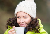 Woman warming up with a cup of tea — Stock Photo