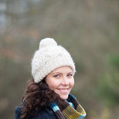 Woman Wearing Muffler And Knitted Hat At Park — Stock Photo