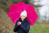 Walking under a pink umbrella — Stock Photo