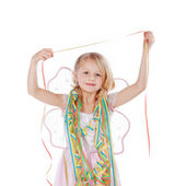 Beautiful little girl draped in party streamers — Stock Photo
