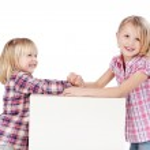 Little Girls Arm Wrestling — Stock Photo #27842801