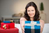 Woman Giving Christmas Gift At Home — Stock Photo
