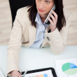 Serious woman discussing an analytical graph — Stock Photo