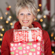 Happy senior with Christmas gifts — Stock Photo