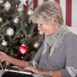 Elderly lady sending Christmas greetings — Stock Photo