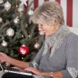 Stock Photo: Elderly lady sending Christmas greetings
