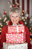 Happy senior with Christmas gifts — Stok fotoğraf