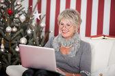 Attractive senior using a laptop — Stock Photo