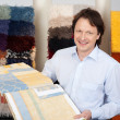 Friendly salesman with fabric samples — Stock Photo