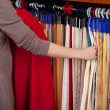 Woman choosing coloured fabric samples — Stock Photo