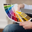 Man holding a set of paint colour swatches — Stock Photo